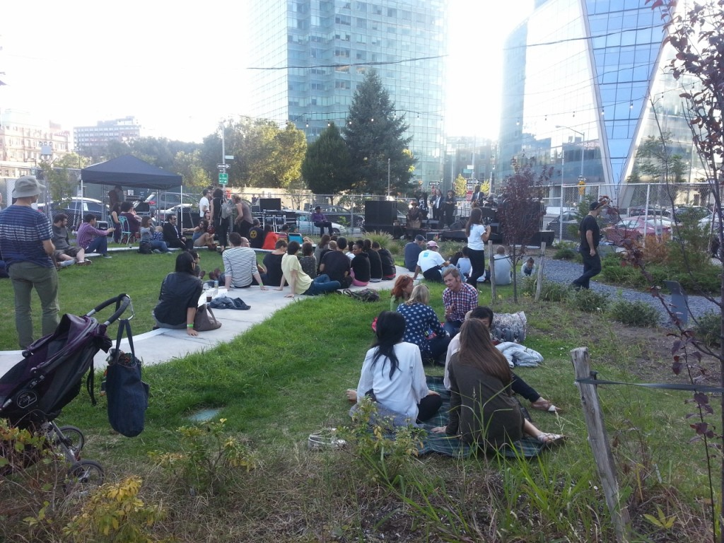 Camping out for new condo sales?  No, it's live music at Lot LIC.  If it were the 60's, everyone would be naked in this pic.